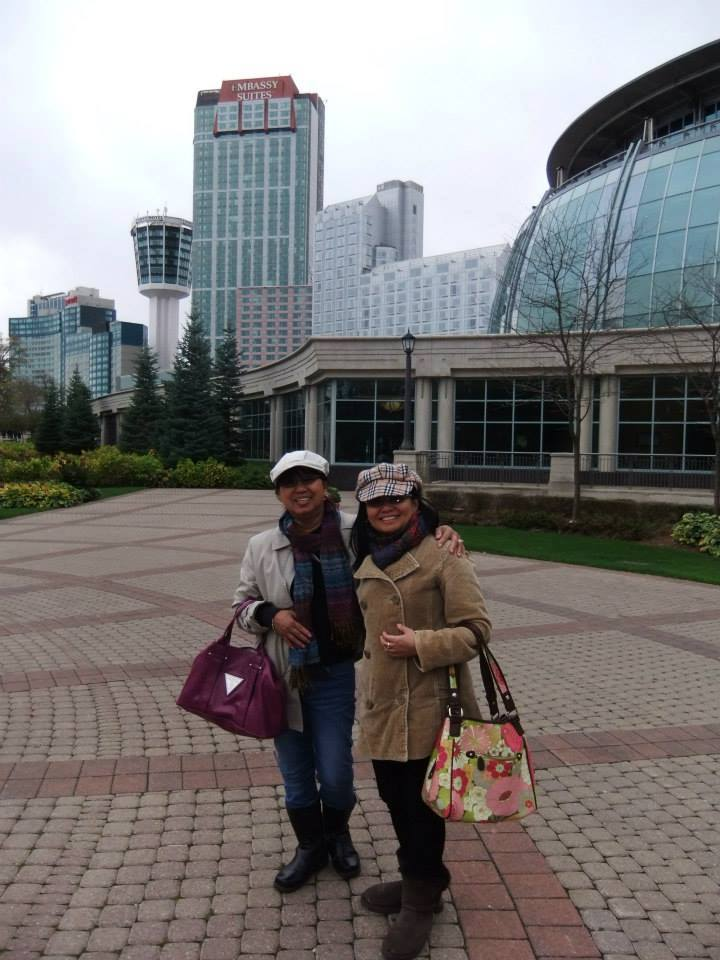 Daydine Alcalde, seen with a friend, has settled in Toronto, landing her first job only after five days of stepping in the city. | Photo from Gerardine Alcalde's Facebook Page