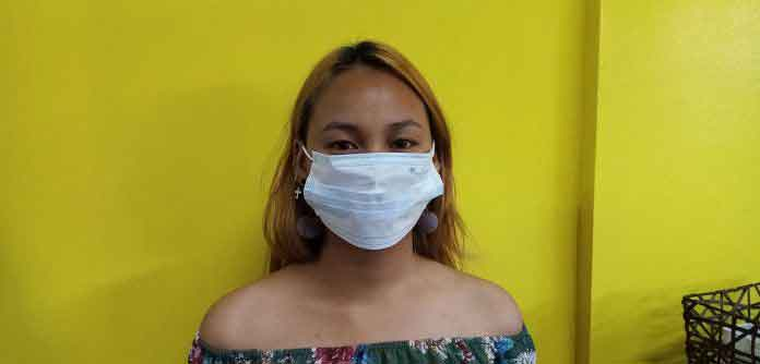 Not recommended way of how to wear a surgical mask.   Photo by Richard D. Meriveles