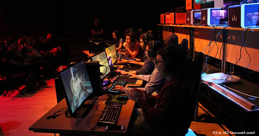 """""""Image taken of Imperial College London vs. University College London during their Varsity January 2018 match up. Here both teams are competing in Overwatch 6v6 using RAZER and DinoPC equipment."""" by EsportsNews is licensed under CC BY-SA 4.0"""