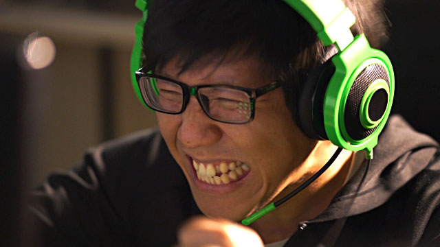 """""""Asian male gamer celebrating his winning in computer game battle video"""" by Lyncconf Games is licensed under CC BY 2.0"""