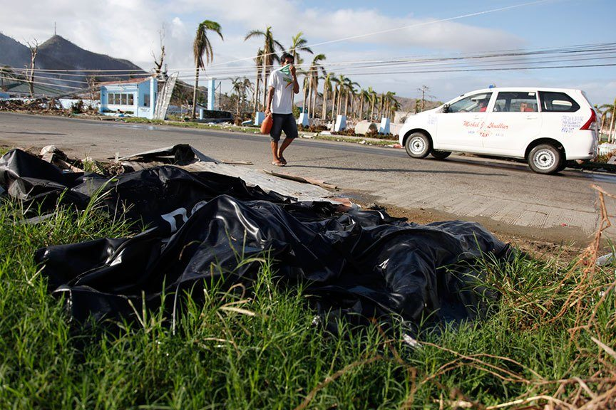 A WEEK AFTER 8 November 2007, some dead bodies placed in bags, have yet to be collected in Tacloban City after superstorm Yolanda struck the Philippines. | Photo by Julius D. Mariveles