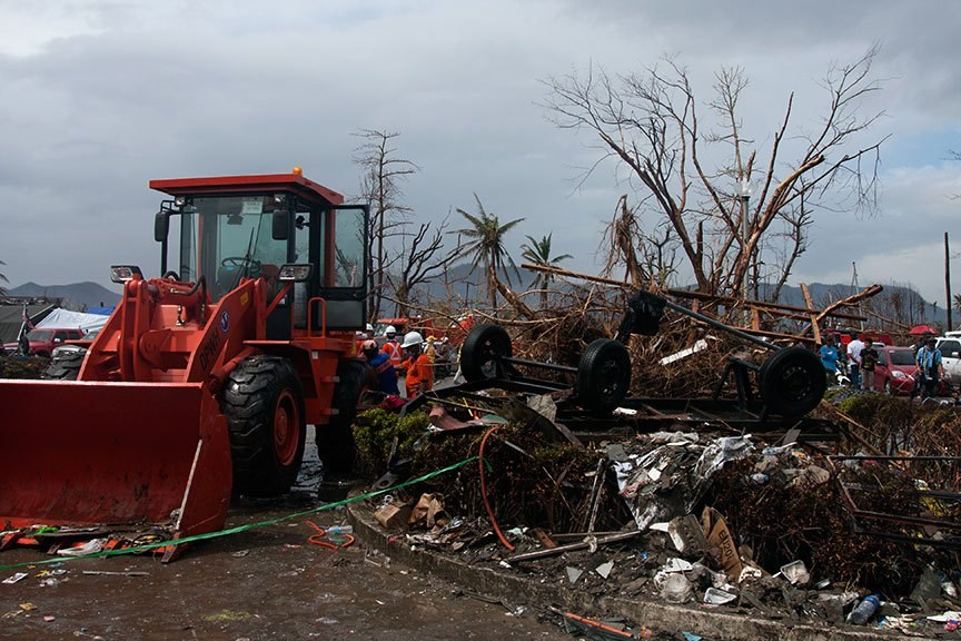 DEBRIS, LOTS OF DEBRIS. Lots of loading and disposing was one of the urgent tasks in Tacloban City, as shown in this photo taken a week after the superstorm struck the country. Tacloban was among the hardest hit areas in the Visayas. | Photo by Julius D. Mariveles