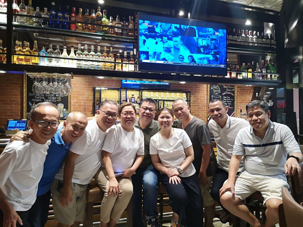 Nick Lizares, third from left, with his eight other siblings among them Larry, second from right, in a photo taken  last year in a pub in Metro Manila. | Photo by Issa Lizares used with permission