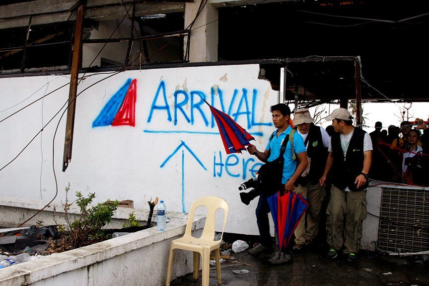 The remains of the arrival area of the Daniel Z. Romualdez Airport in Tacloban City looks like a grafitti wall a week after the superstorm, Yolanda (international codename Ruby) struck the Philippines, displacing at least a million in the Visayas group of islands alone. Close to 7,000 are believed to have been killed, according to government estimates. | Photo by Julius D. Mariveles