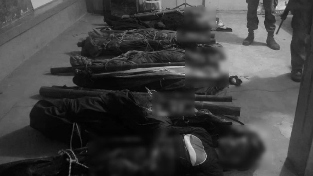 The bodies of suspected rebels slain in a firefight with soldiers 23 March in an upland village in Guihulngan City in improvised bodybags. | Photo courtesy of 303rd IB.