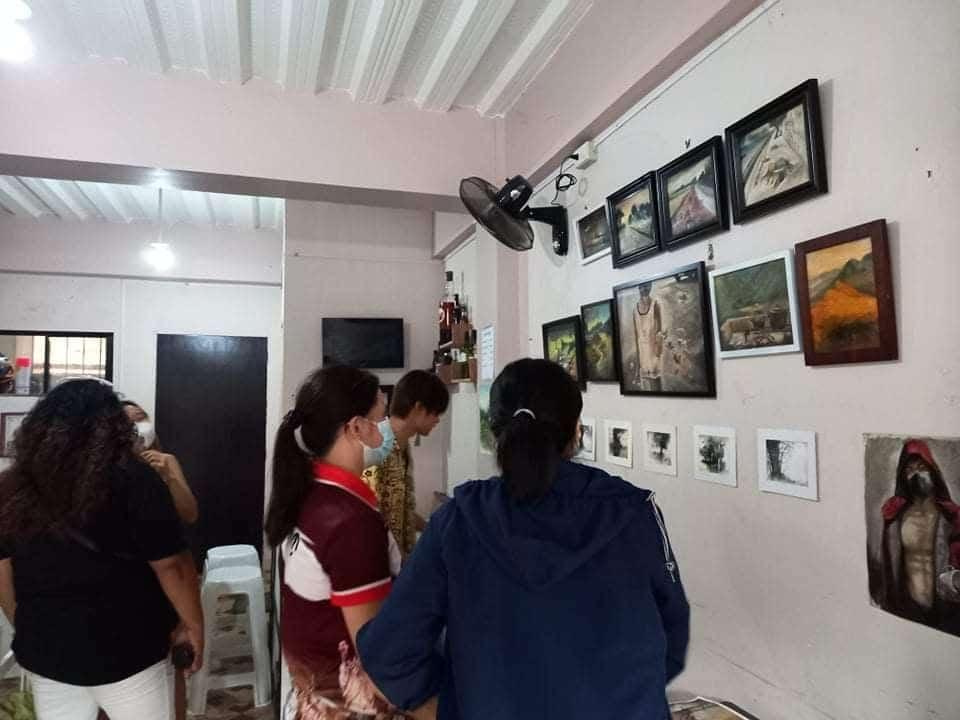 crowd gather around for kyles art