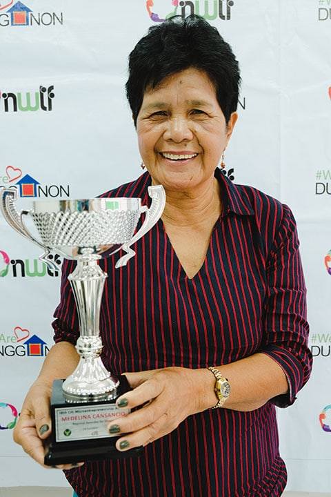 Nanay Medelina, Dungganon Client of 20 years wins regional award for the Visayas in the 18th Citi Microentrepreneurship Awards. | Photo by NWTF
